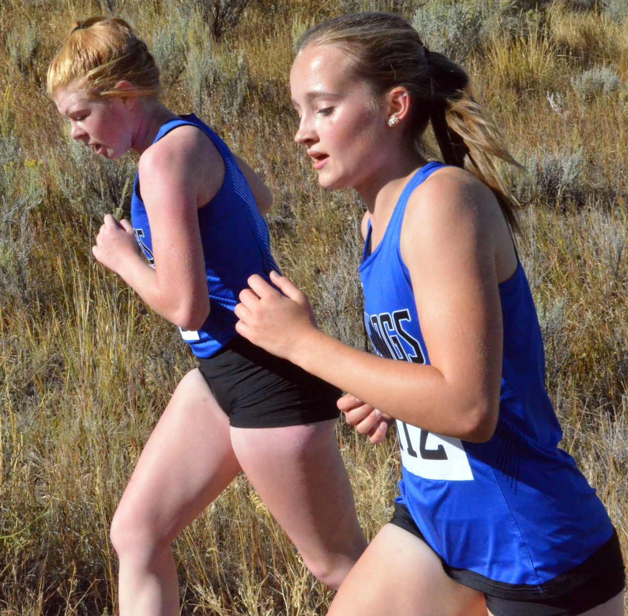 Moffat County High School's Bree Meats and Alayna Behrman push on during Saturday's MCHS Invitational.