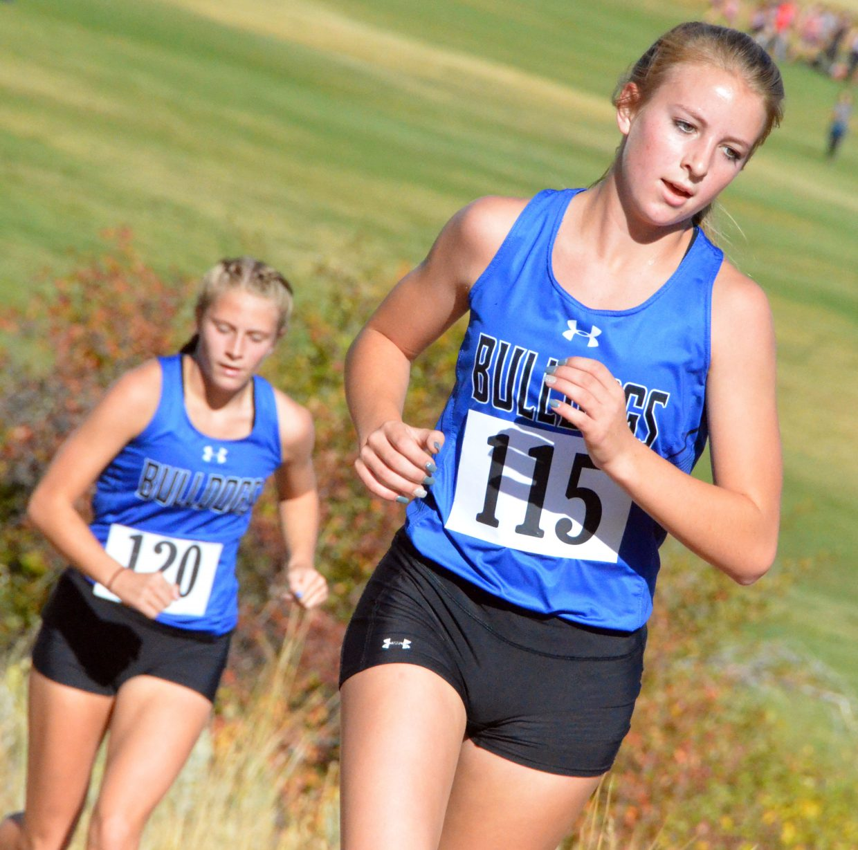 Moffat County High School's Halle Hamilton, foreground, and Kelsey McDiffett work with an incline during Saturday's MCHS Invitational.