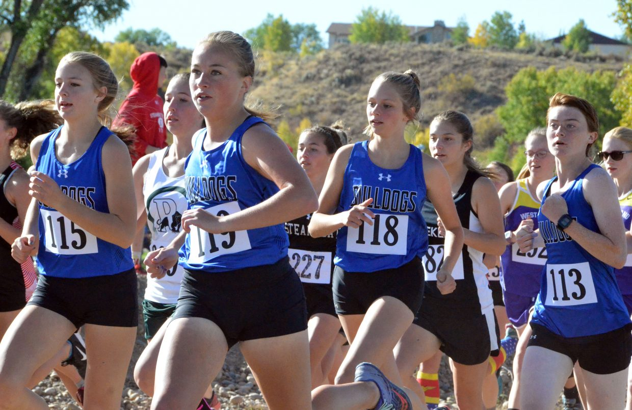 Moffat County High School girls cross country seeks to stay in front at the start of Saturday's MCHS Invitational.