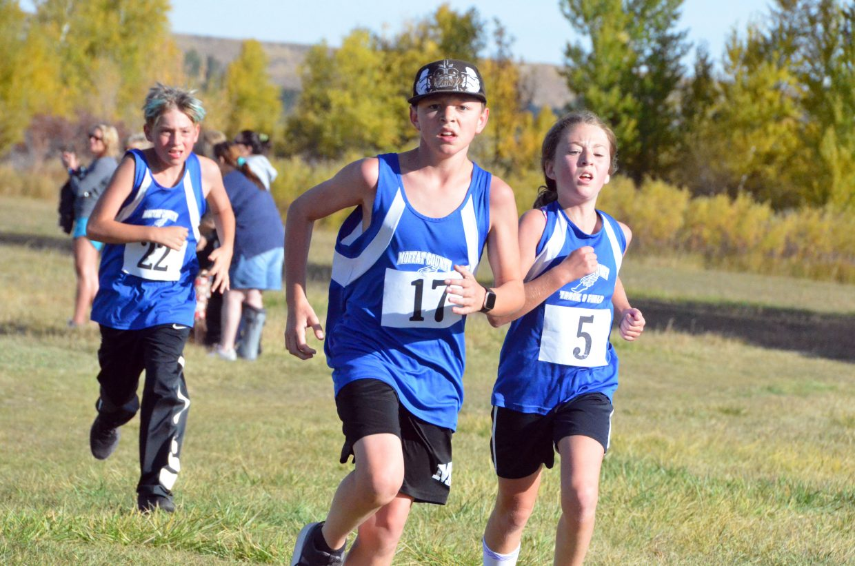 From left, Craig Middle School runners Mason Lorio, Zach Craig and Hannah Kilpatrick approach the chute during Saturday's MCHS Invitational.