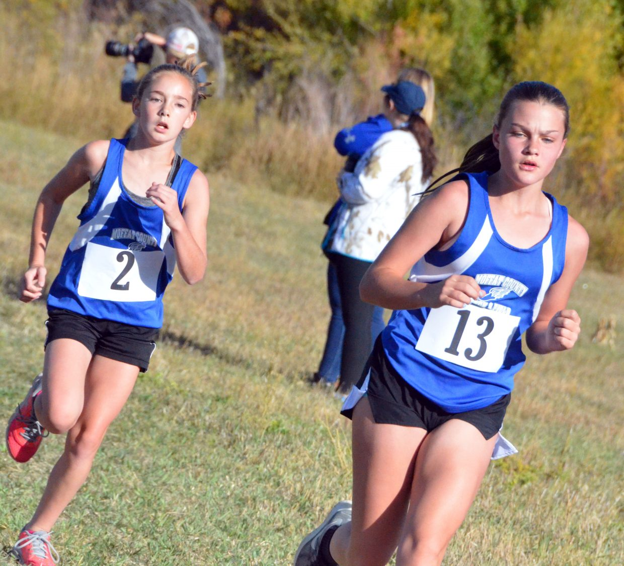Craig Middle School runners Ariana Buchanan, left, and Brook Wheeler are almost to the finish line during Saturday's MCHS Invitational.