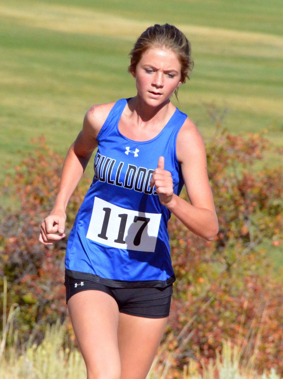 Moffat County High School's Liberty Hippely takes one last incline during Saturday's MCHS Invitational.