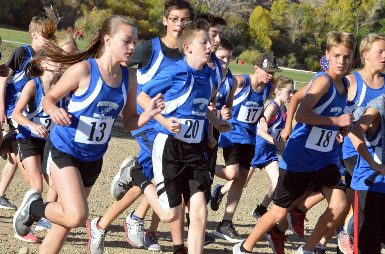 Craig Middle School cross country runners get warmed up before Saturday's MCHS Invitational.