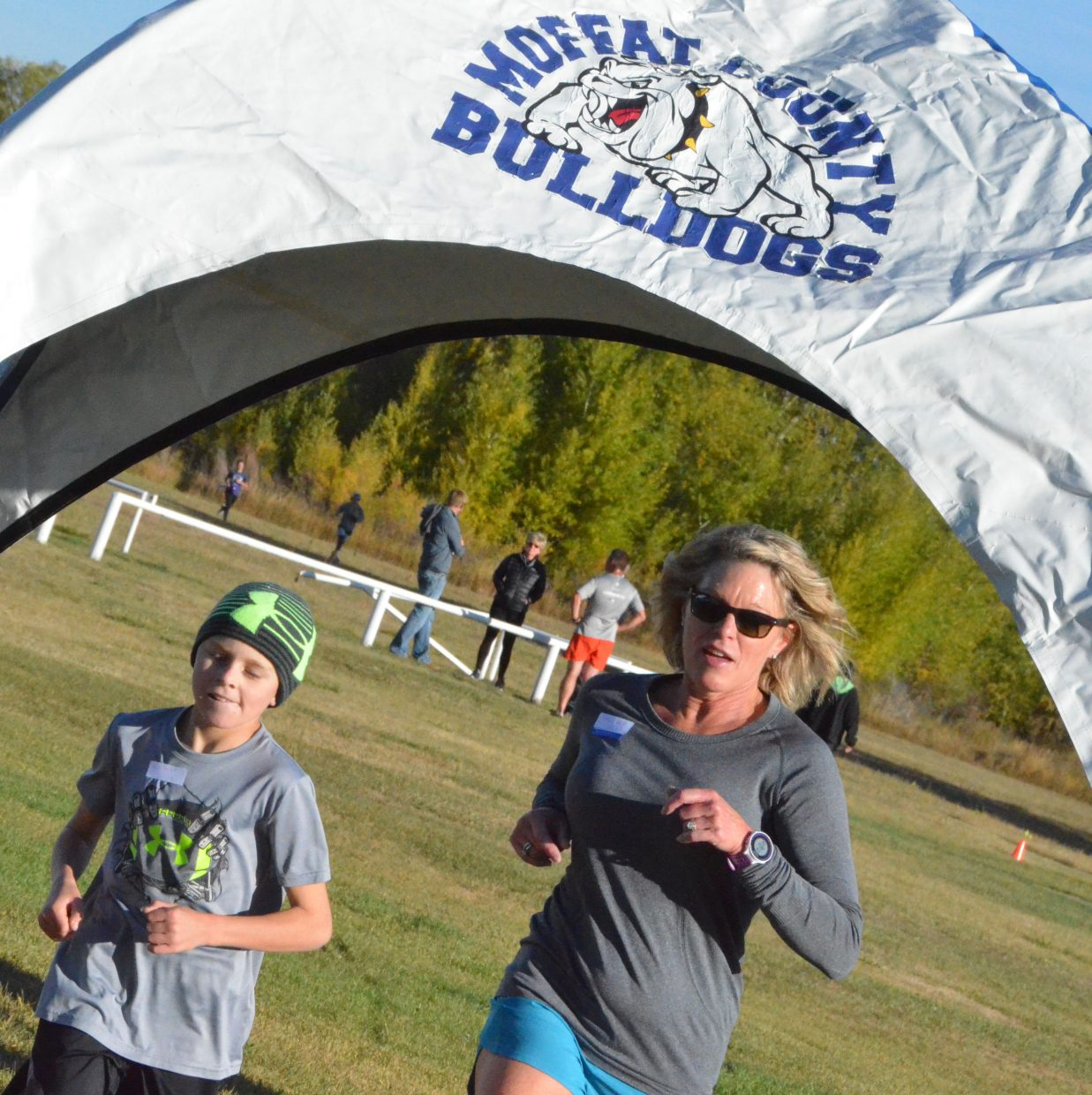Runners cross the finish line during Saturday's Friends of Moffat County Education Leaf Cruncher 5K.