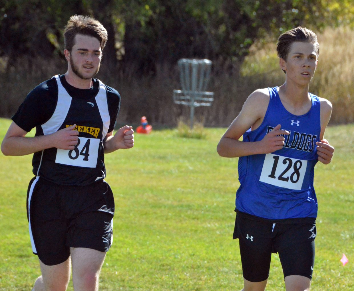 Moffat County High School's Wilson Eike comes off the Loudy-Simpson hill and stays close with Meeker competition in Saturday's MCHS Invitational.