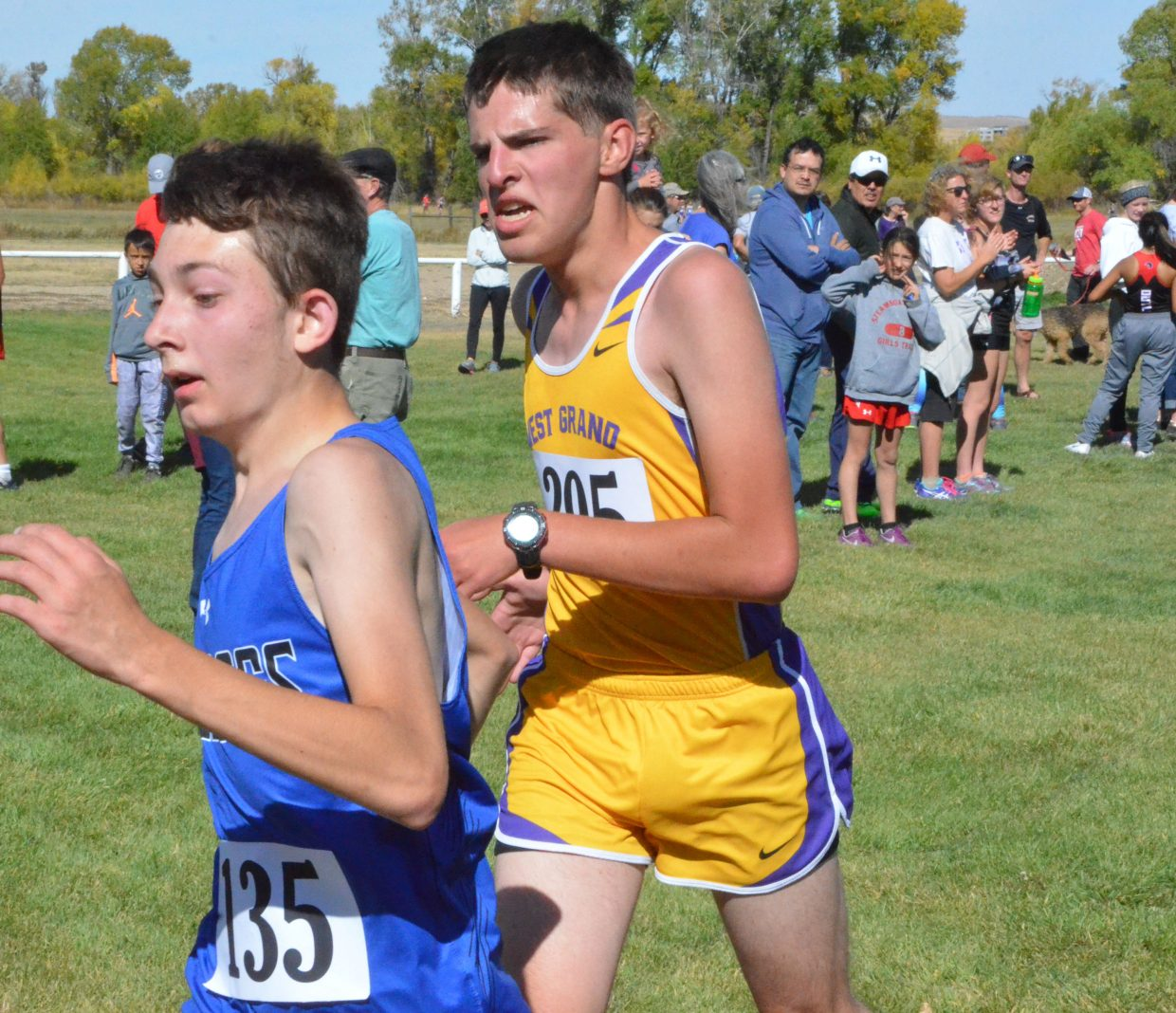 Moffat County High School's Chase Lorio sneaks past the West Grand competition at the finish line during Saturday's MCHS Invitational.
