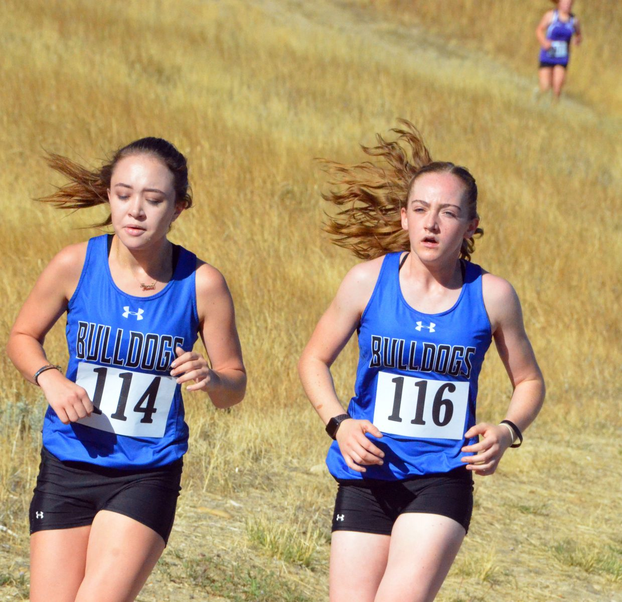 Moffat County High School's Fiona Connor and Raine Harrell stick close together during Saturday's MCHS Invitational.