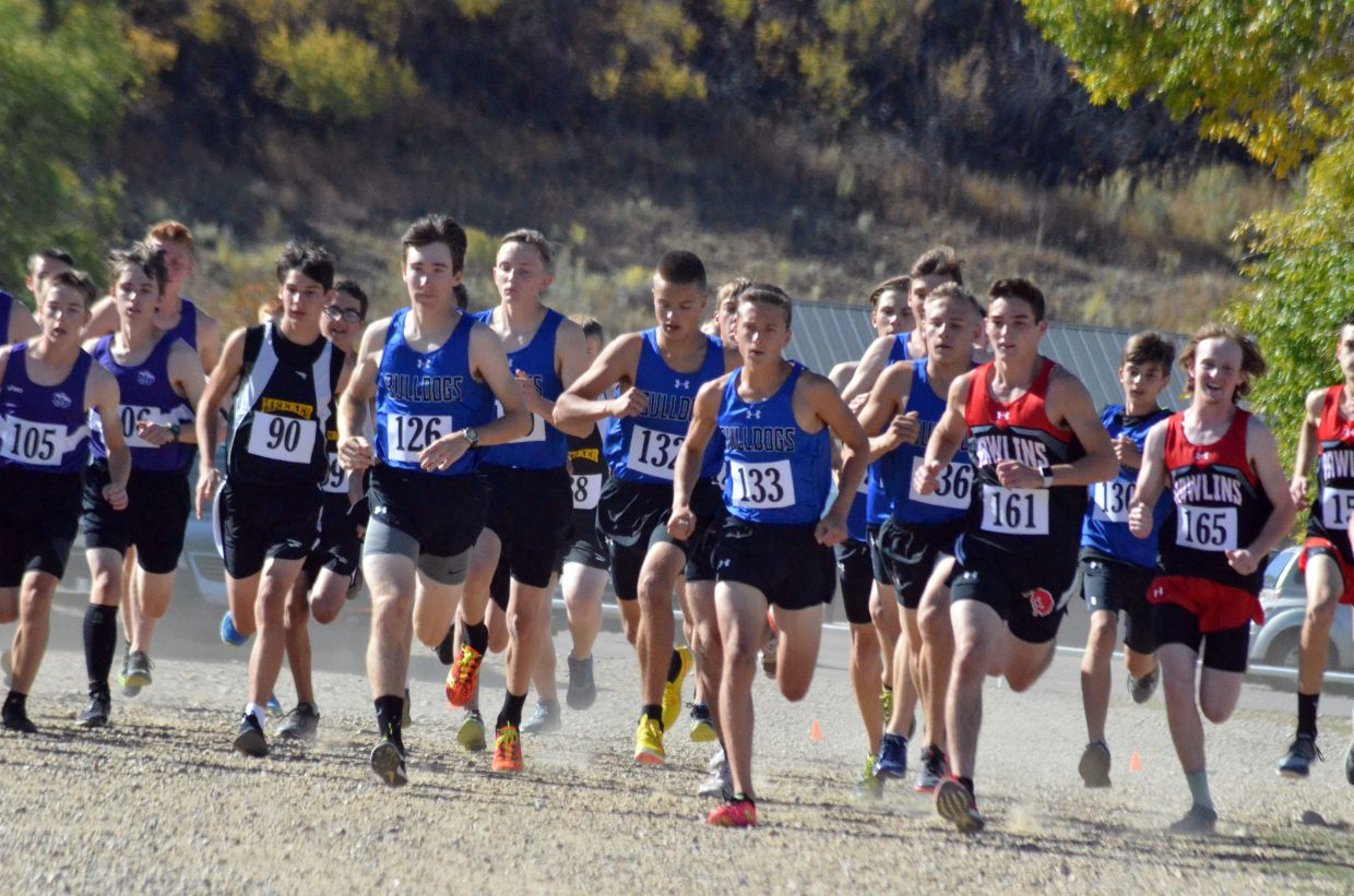 Moffat County High School boys cross country runners take off from the starting line during Saturday's MCHS Invitational.
