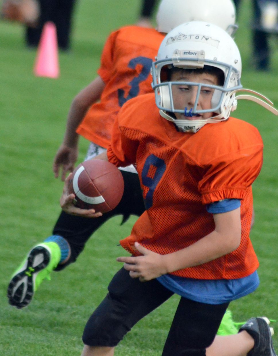 The Broncos' Weston Swaro keeps the ball following a fake handoff during a Doak Walker third- and fourth-grade game.