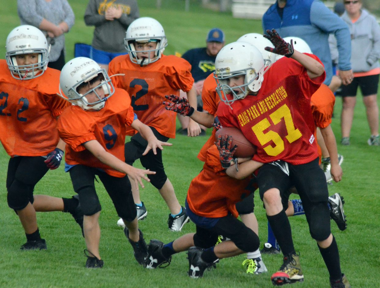 The Chiefs' Tanner Musgrave charges in the Bronco secondary during a Doak Walker third- and fourth-grade game.