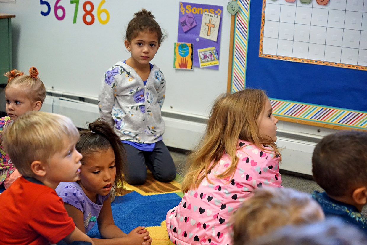 Madison Camilletti looks away from the illustration of germs during a story about the importance of washing and drying hands to prevent illnesses.