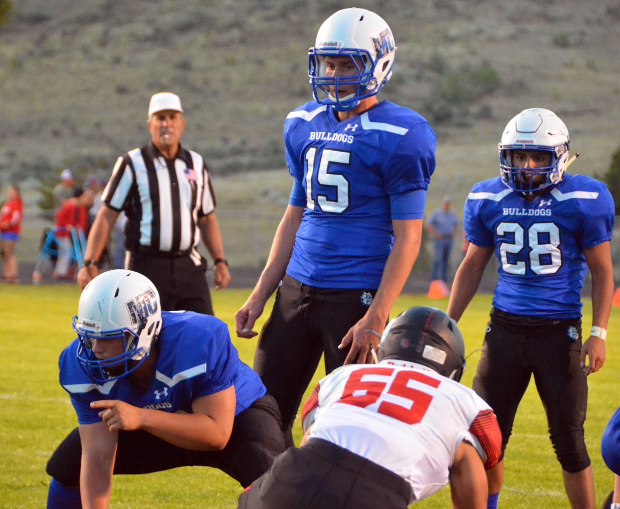From left, Moffat County High School center Logan Knez, quarterback Colby Beaver and running back Kevin Hernandez are ready to score at the goal line against Steamboat Springs.