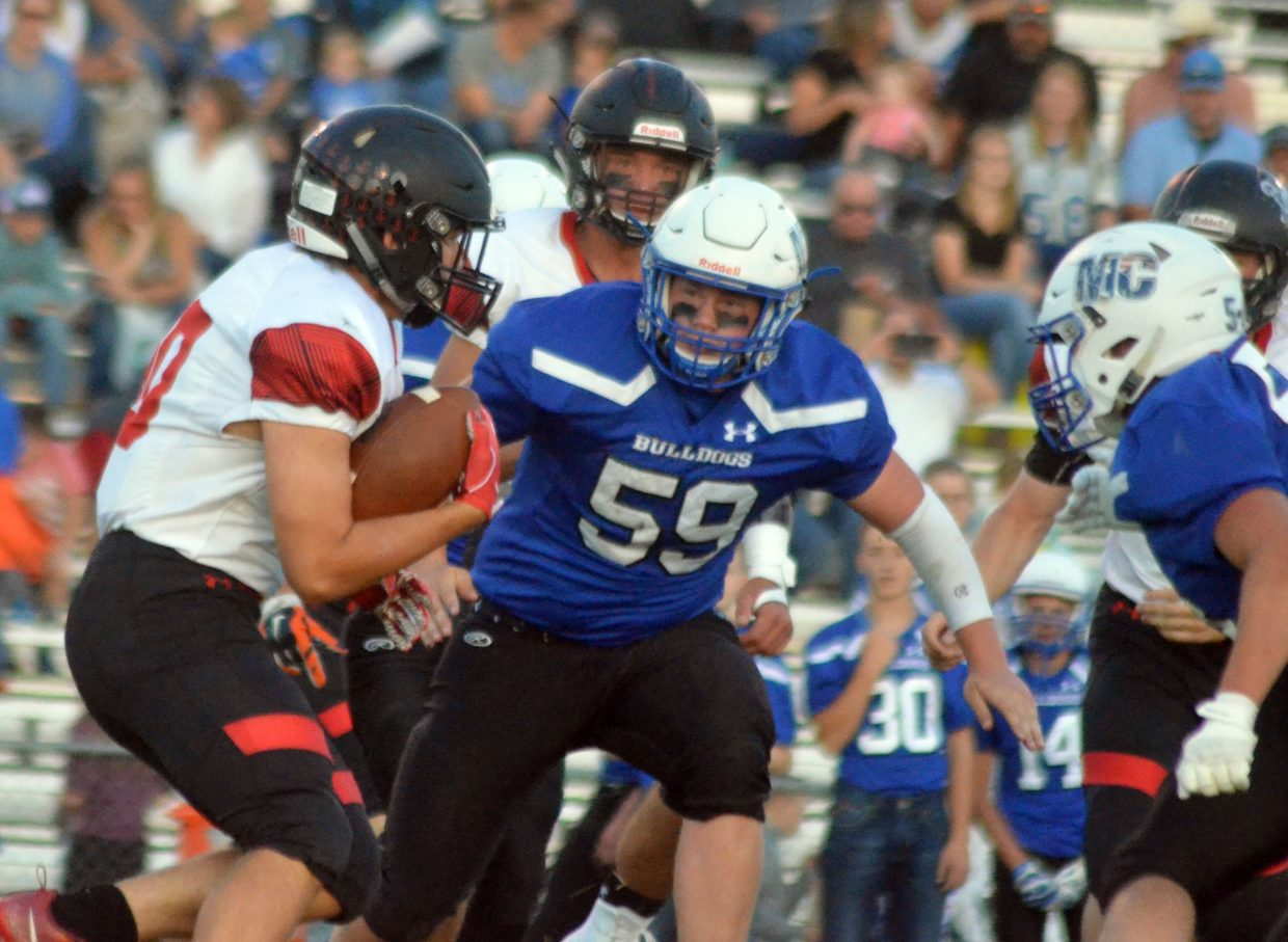 Moffat County High School's Corey Scranton closes in on Steamboat Springs rusher Finn Russell.