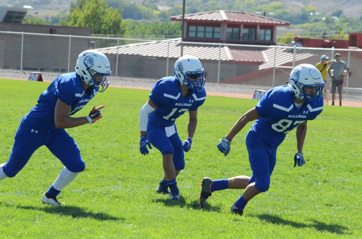 From left, Moffat County High School's Cale Scranton, Victor Silva and Dario Alexander line up in trips formation.