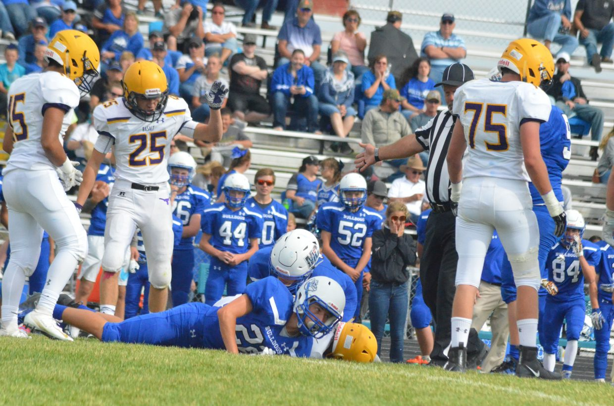 Moffat County High School and Basalt players pile up on a fumble during Saturday's Homecoming game.