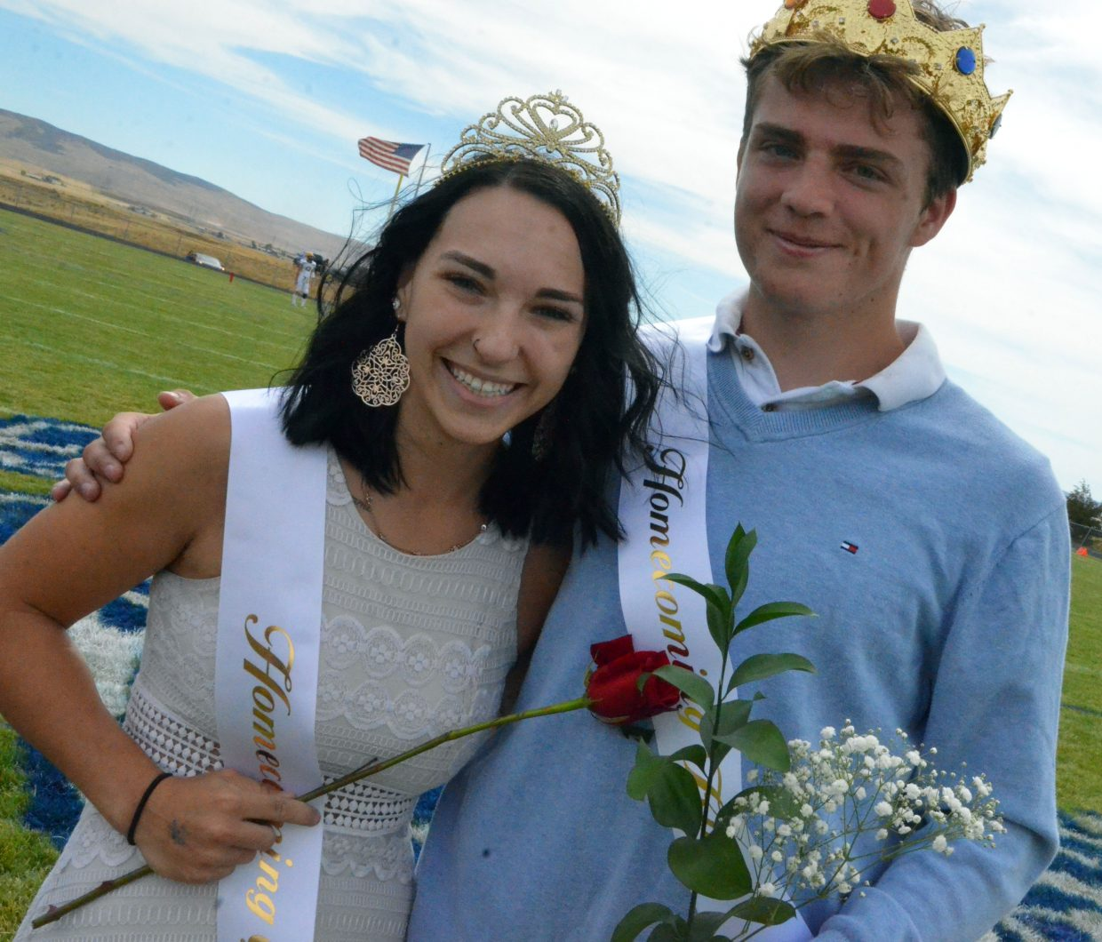 Moffat County High School's Quinn Pinnt and Jared Atkin accept queen and king honors at halftime during Saturday's Homecoming game with Basalt.