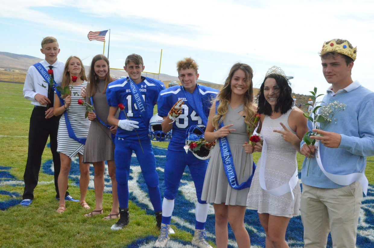 Moffat County High School's royalty and attendants take one more group photo at halftime during Saturday's Homecoming game with Basalt.