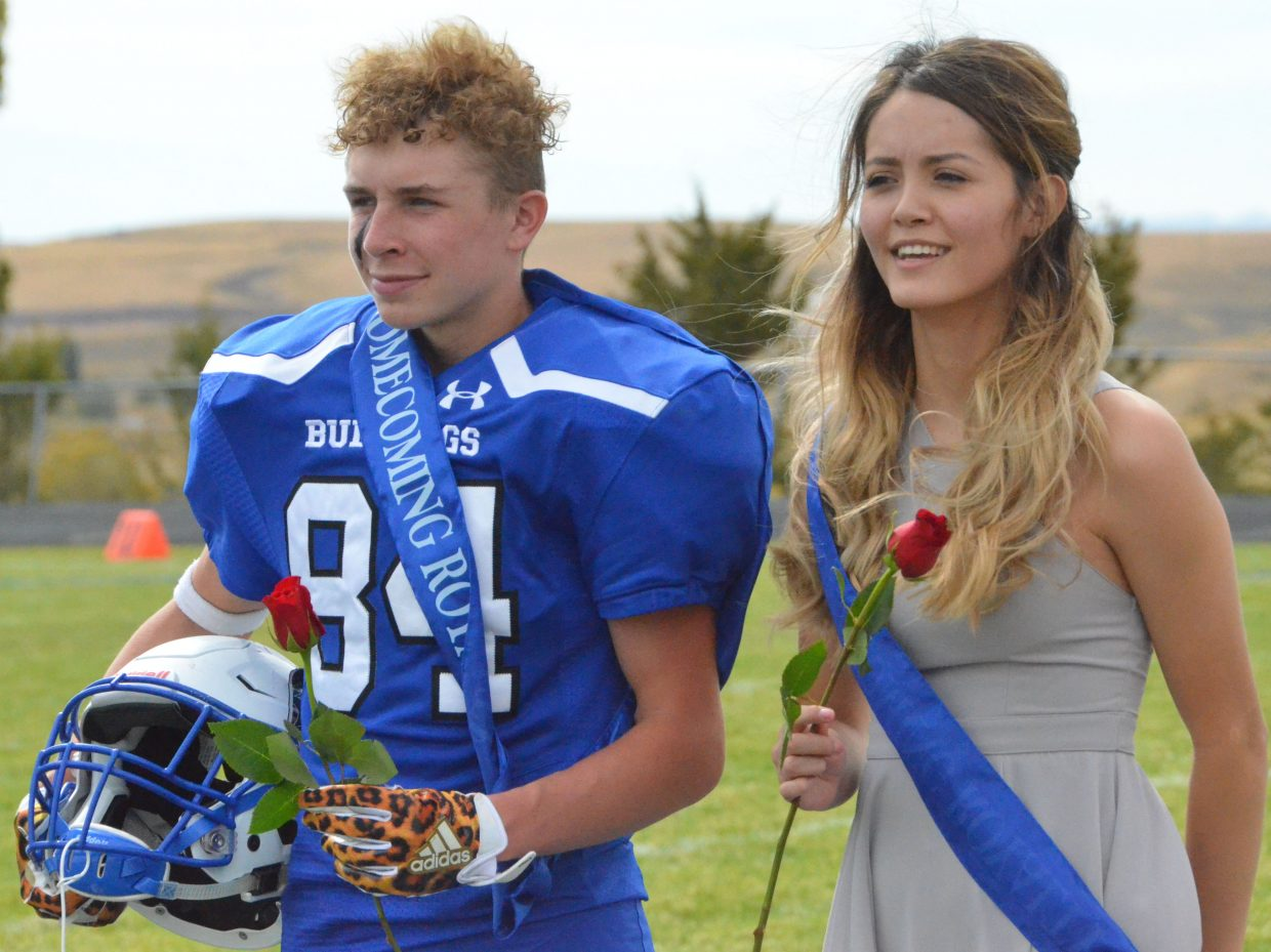 Moffat County High School's Dagan White and Marlyn Arellano accept junior attendant honors at halftime during Saturday's Homecoming game with Basalt.