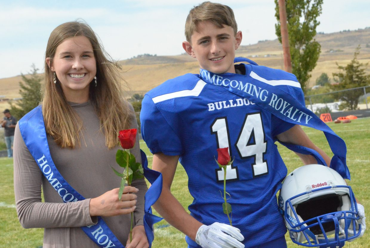 Moffat County High School's Emaleigh Papierski and Blake Juergens accept sophomore attendant honors at halftime during Saturday's Homecoming game with Basalt.