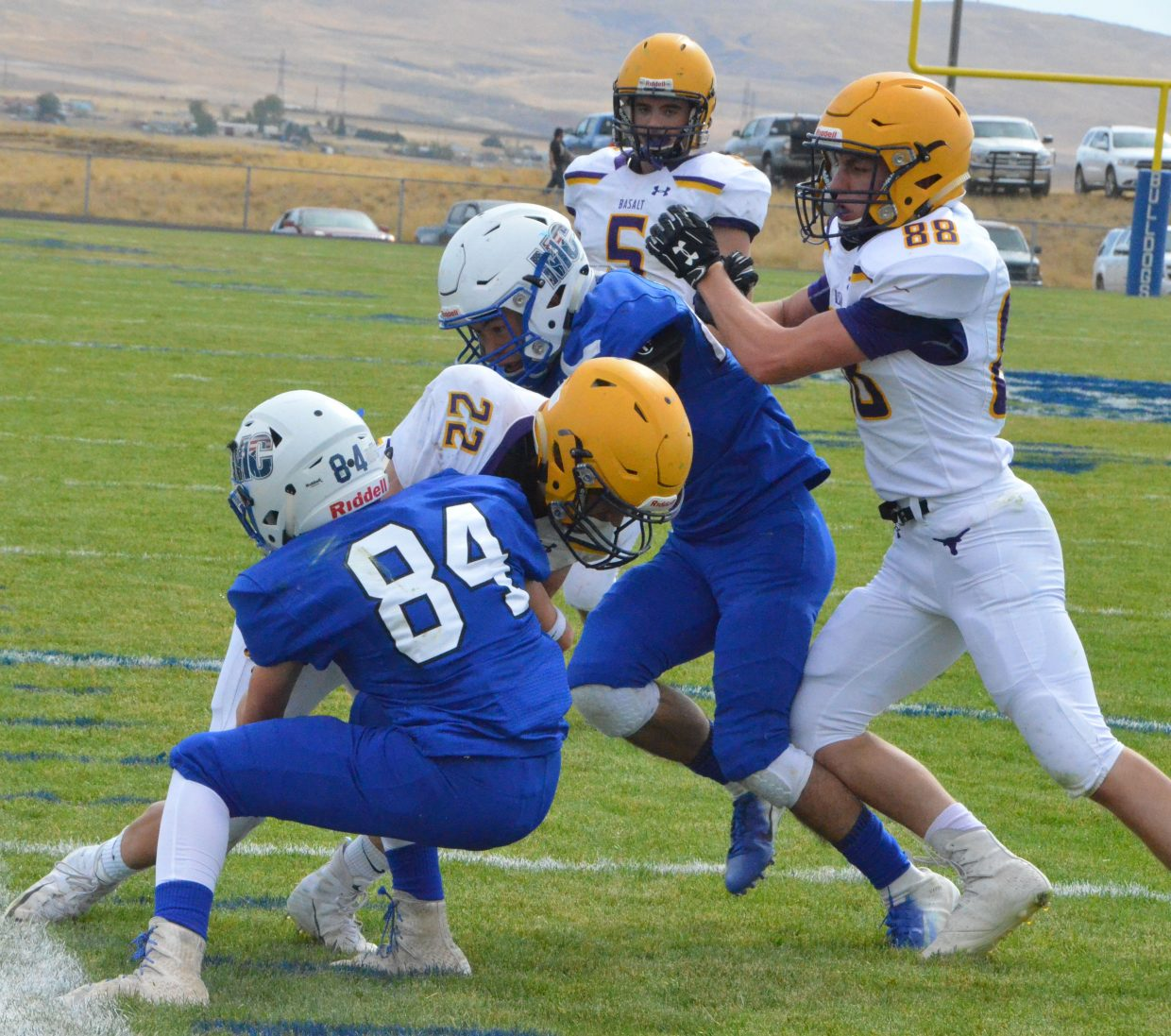 Moffat County High School's Dagan White and Josh Teeter are both in for the stop against Jake Reardon during Saturday's Homecoming game with Basalt.
