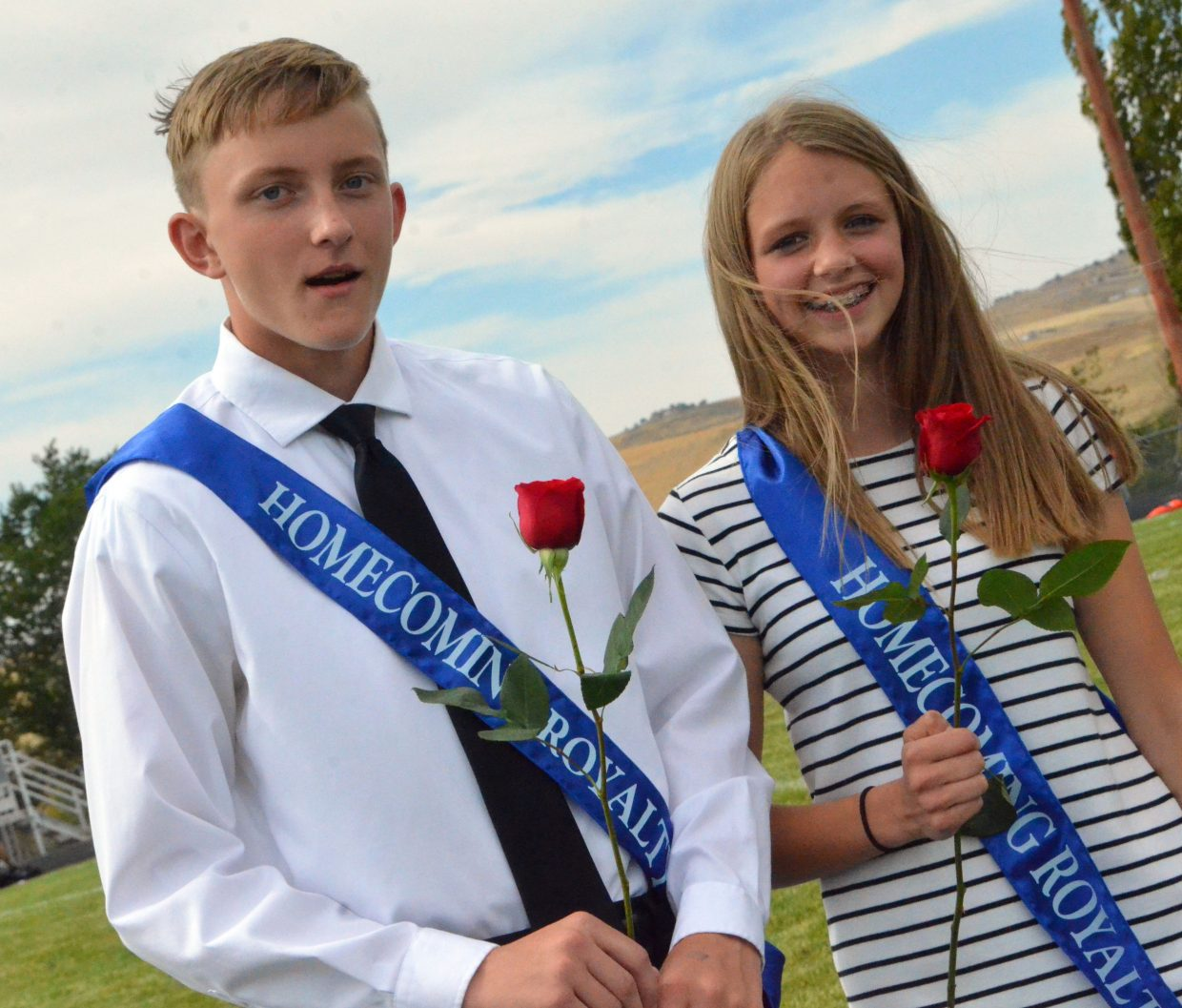Moffat County High School's Logan Hafey and Emma Jones accept freshman attendant honors at halftime during Saturday's Homecoming game with Basalt.