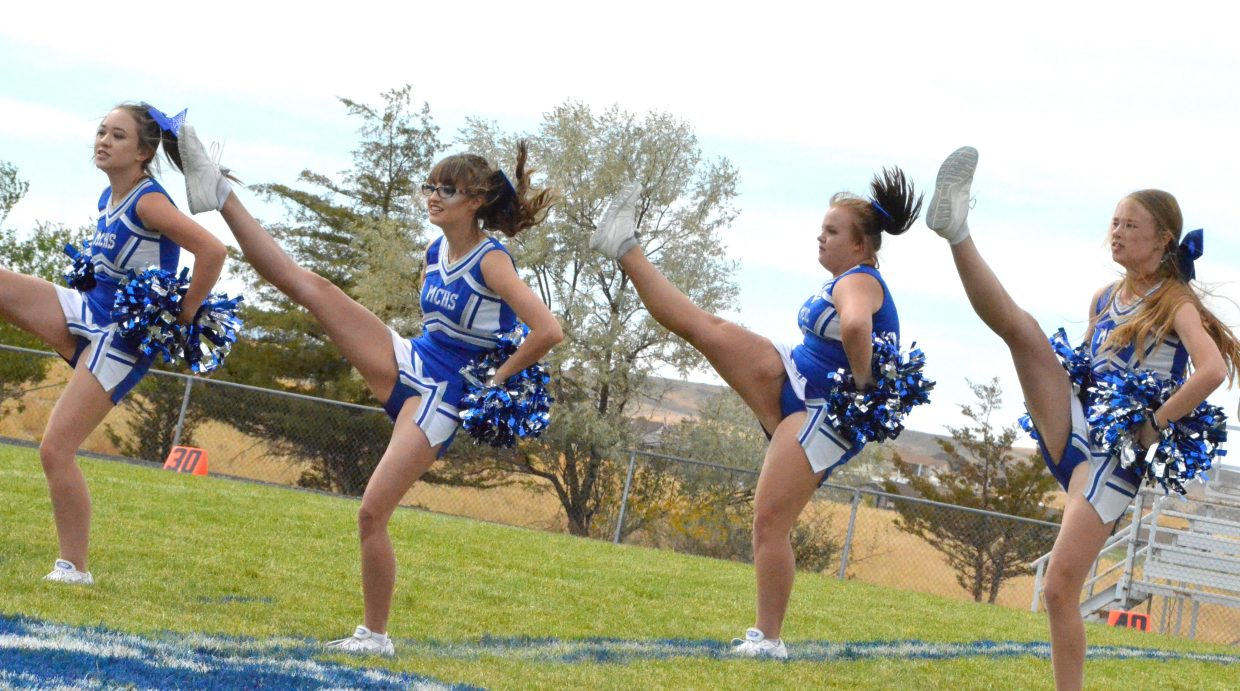 Moffat County High School cheerleaders add a little kick to their halftime show during Saturday's Homecoming game with Basalt.