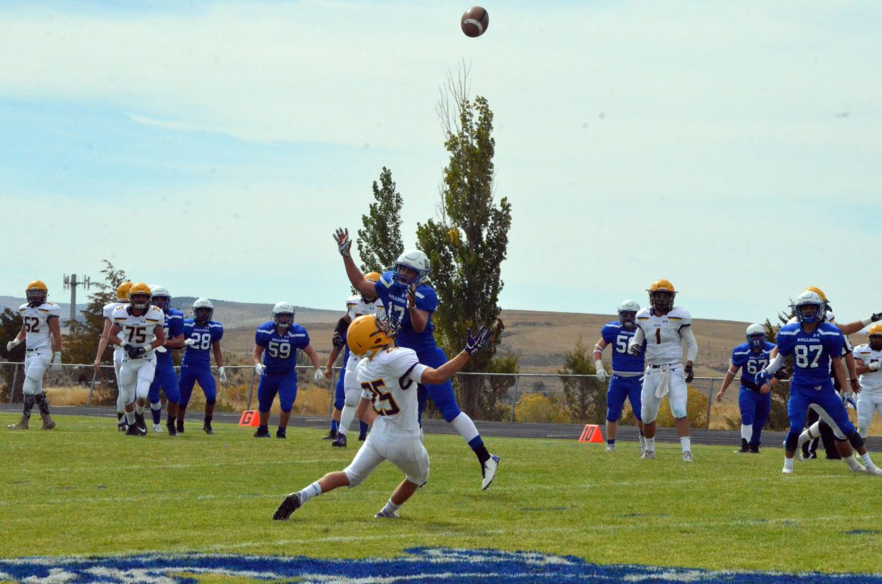 The ball catches some extra air as Moffat County and Basalt battle in deep pass coverage during Saturday's Homecoming game with Basalt.