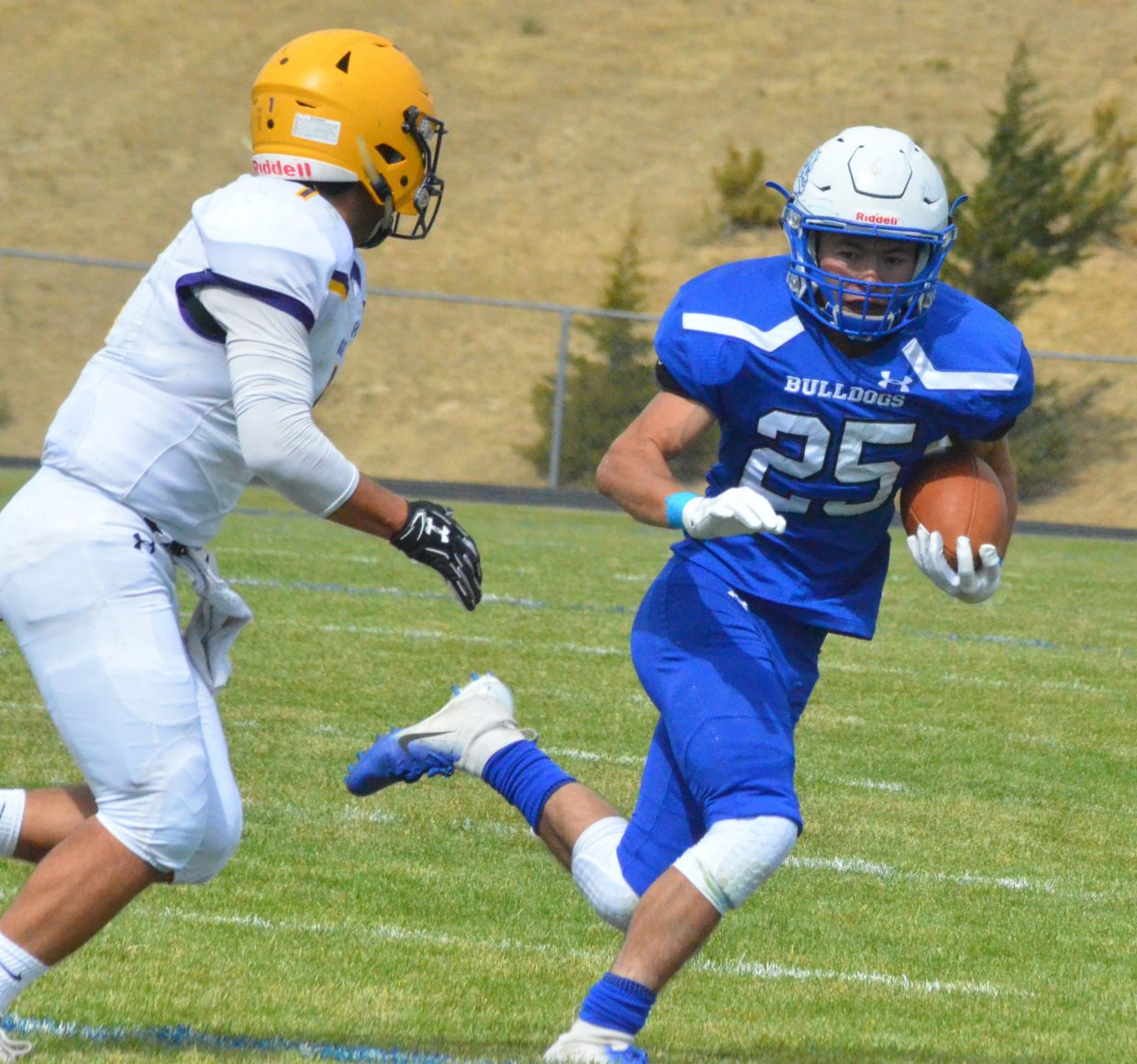 Moffat County High School's Josh Teeter sweeps out to get around Basalt during Saturday's Homecoming game.