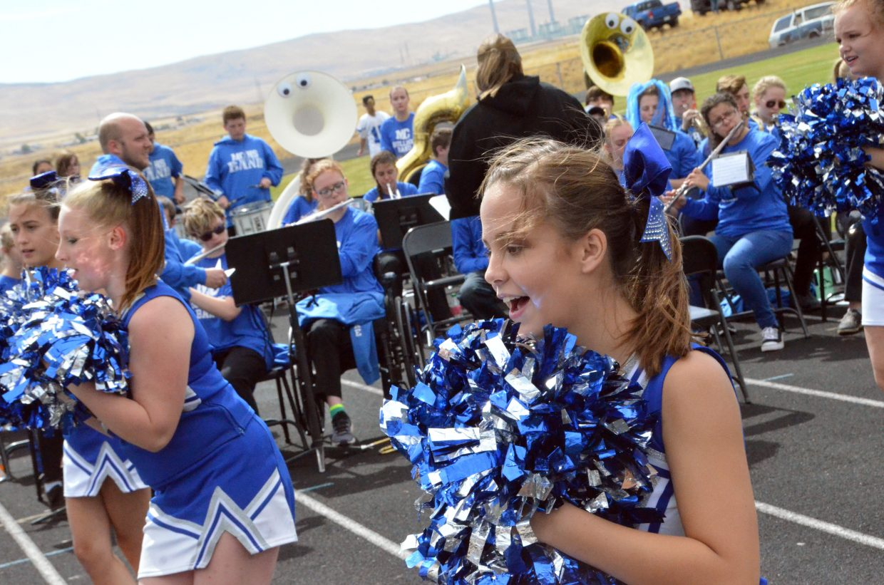 Moffat County High School cheerleaders and the MCHS band get the crowd going to start Saturday's Homecoming game.