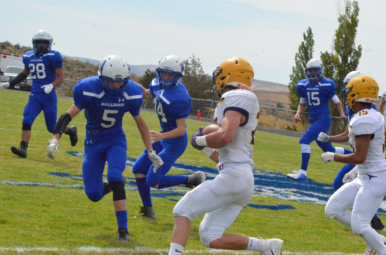 Moffat County High School's Ethan Hafey bears down on Basalt's Jake Reardon during the Bulldogs' Saturday Homecoming game.