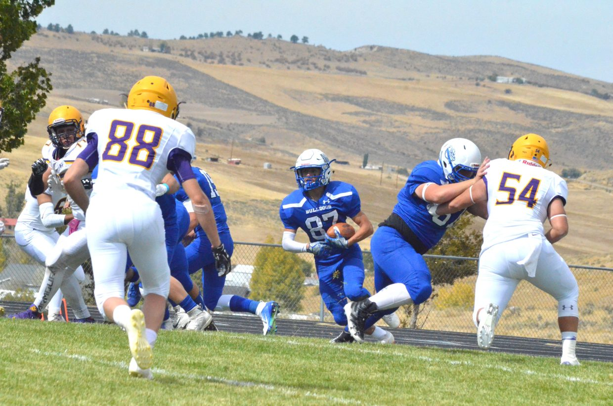 Moffat County High School's Dario Alexander looks for a gap on the Bulldogs' opening drive during Saturday's Homecoming game with Basalt.