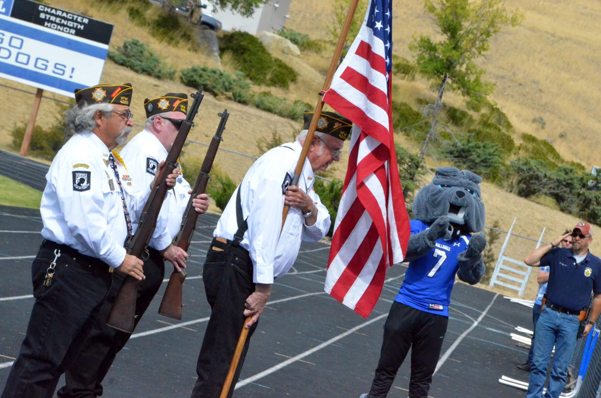 Crag veterans serve as a color guard to start Moffat County High School's Homecoming game with Basalt.