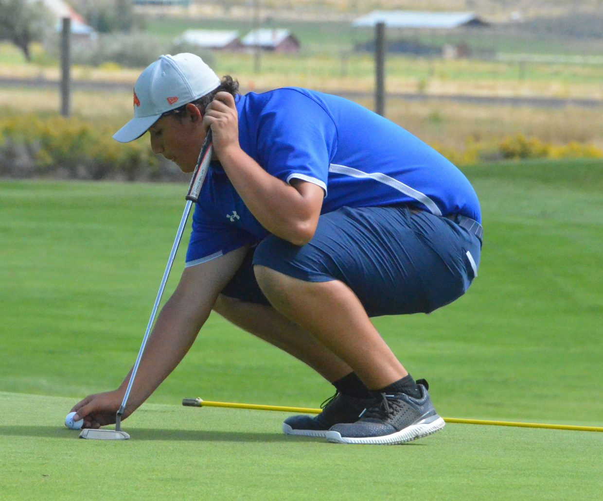 Moffat County High School's Dave Andujo  marks his ball Wednesday on Yampa Valley Golf Course's sixth green during the MCHS Invitational.