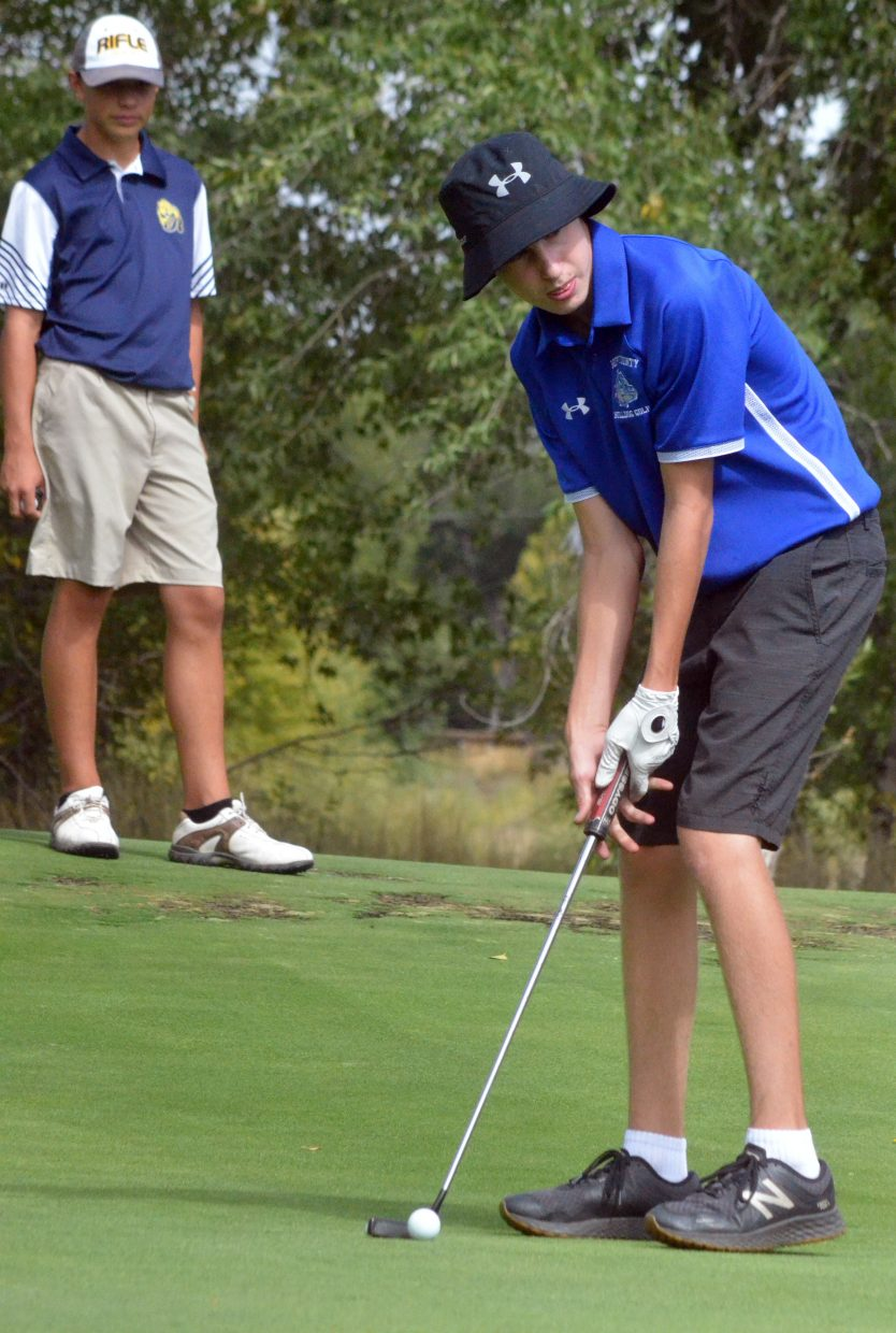 Moffat County High School's Tyler Burkett eyes his putt Wednesday on Yampa Valley Golf Course's seventh green during the MCHS Invitational.