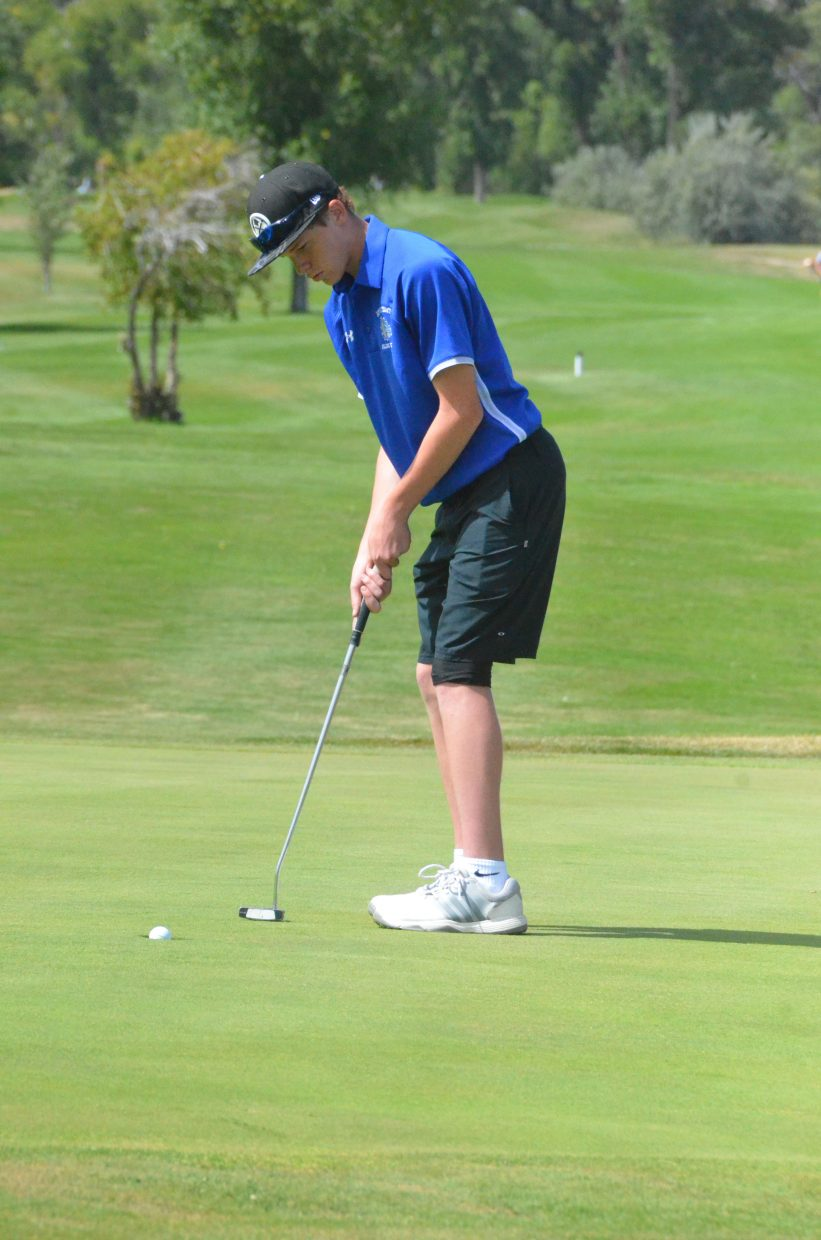 Moffat County High School's Josh Townsend sinks a short putt Wednesday on Yampa Valley Golf Course's 18th green during the MCHS Invitational.