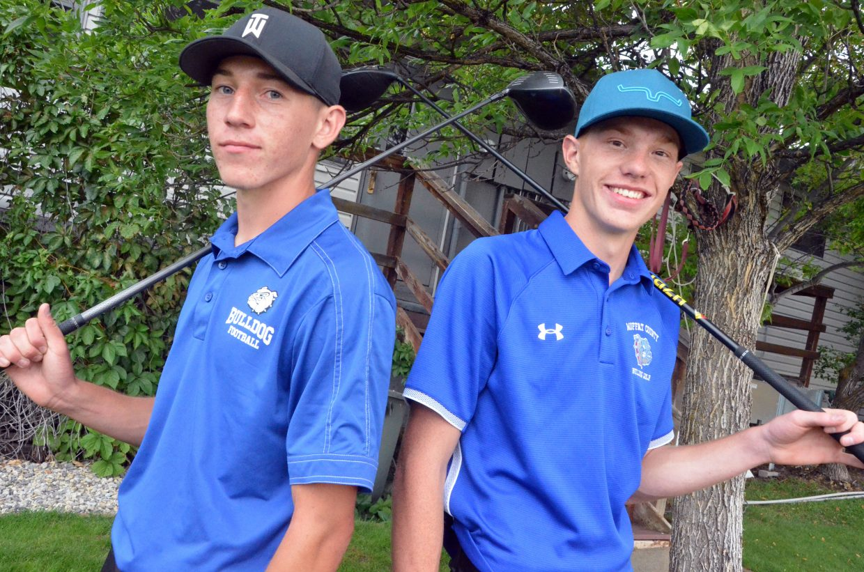 Moffat County High School seniors Connor Etzler, left and Torin Reed finish out their day at the MCHS Invitational.