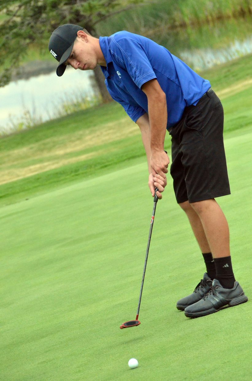 Moffat County High School's Connor Etzler putts Wednesday on Yampa Valley Golf Course's 14th green during the MCHS Invitational.