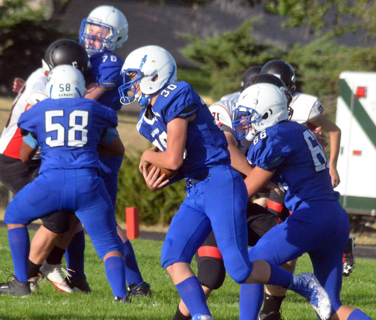 Moffat County High School's Brock Hartung takes command of the ball in the Bulldog backfield.