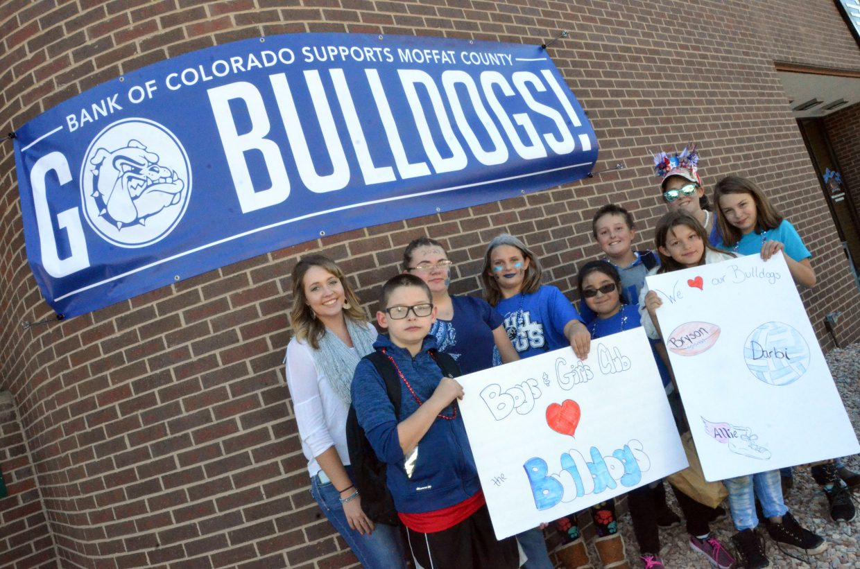 Spectators with Boys & Girls Club of Craig show their pride outside Bank of Colorado during Moffat County High School's Friday Homecoming parade.
