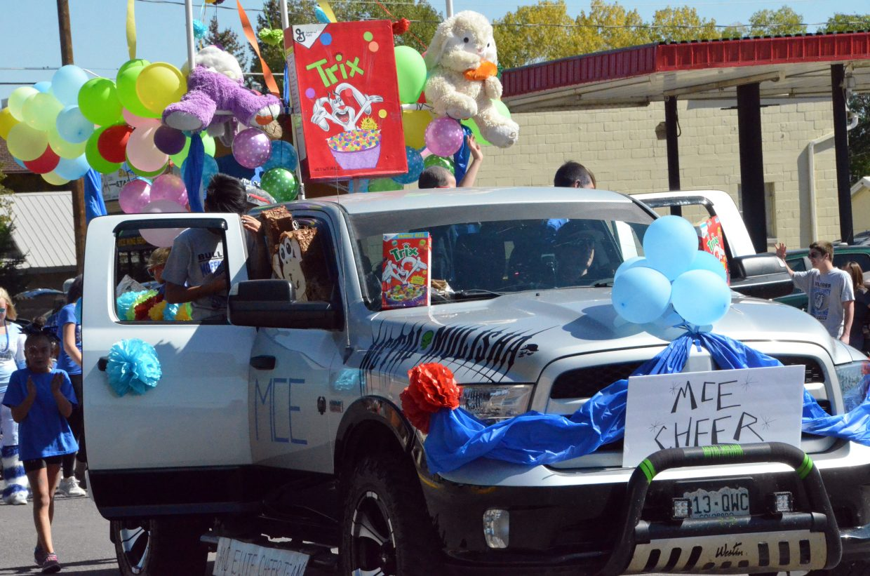 Moffat County Elite Cheer has a Trix theme during Moffat County High School's Friday Homecoming parade.