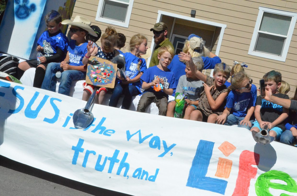 Moffat County Christian Academy's float is packed with students during Moffat County High School's Friday Homecoming parade.