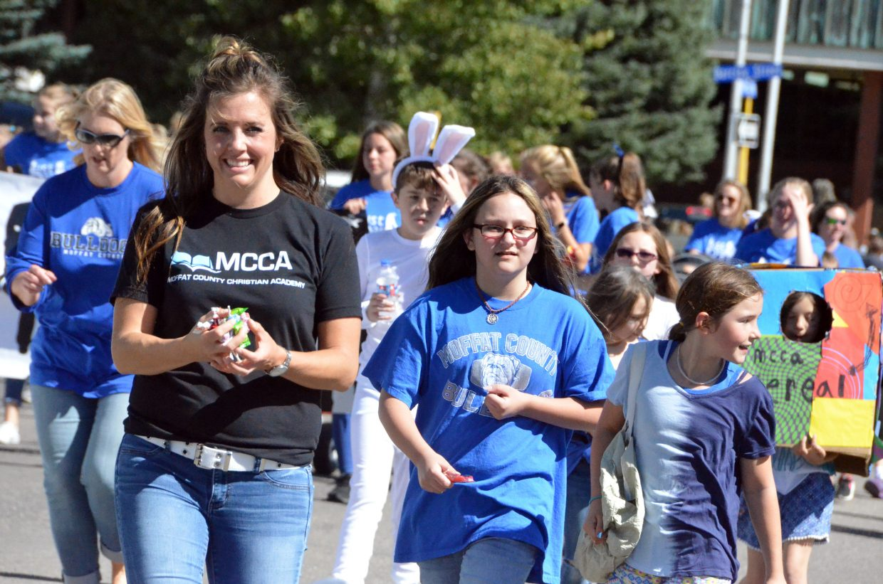 Members of Moffat County Christian Academy march along during Moffat County High School's Friday Homecoming parade.