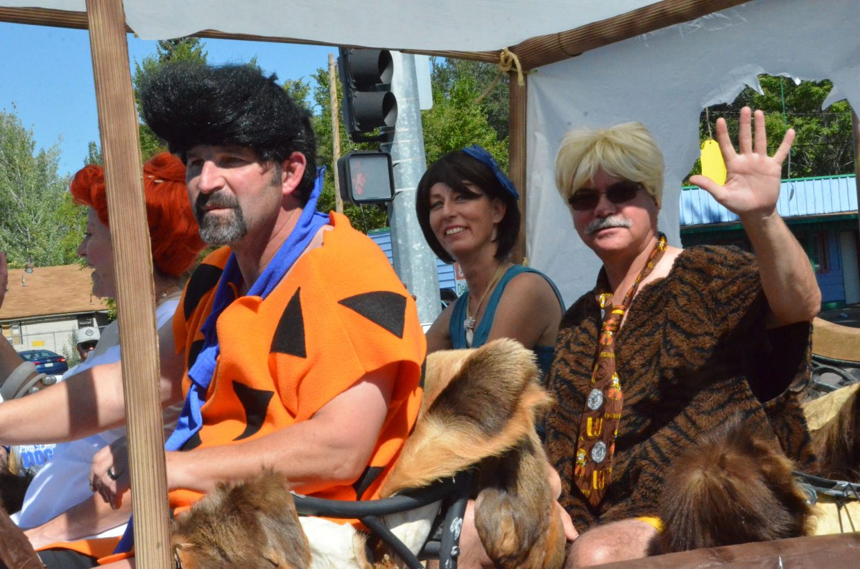 Members of Yampa Valley Bank portray the Flintstones and Rubbles during Friday's Moffat County High School Homecoming parade.