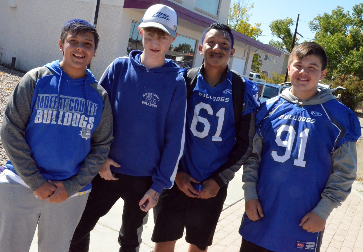 Craig Middle School students wear plenty of Bulldog blue and white during Moffat County High School's Friday Homecoming parade.