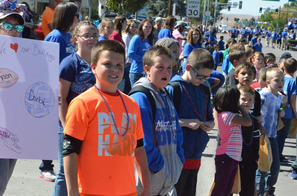 Spectators of all ages enjoy the Moffat County High School Homecoming parade.