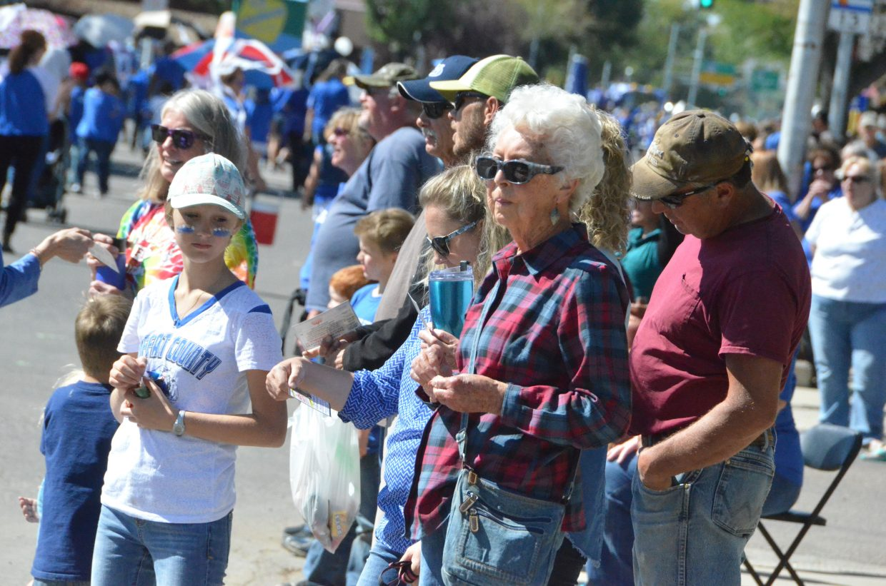 Crowd members observe the sights and sounds of the Moffat County High School Homecoming parade Friday.