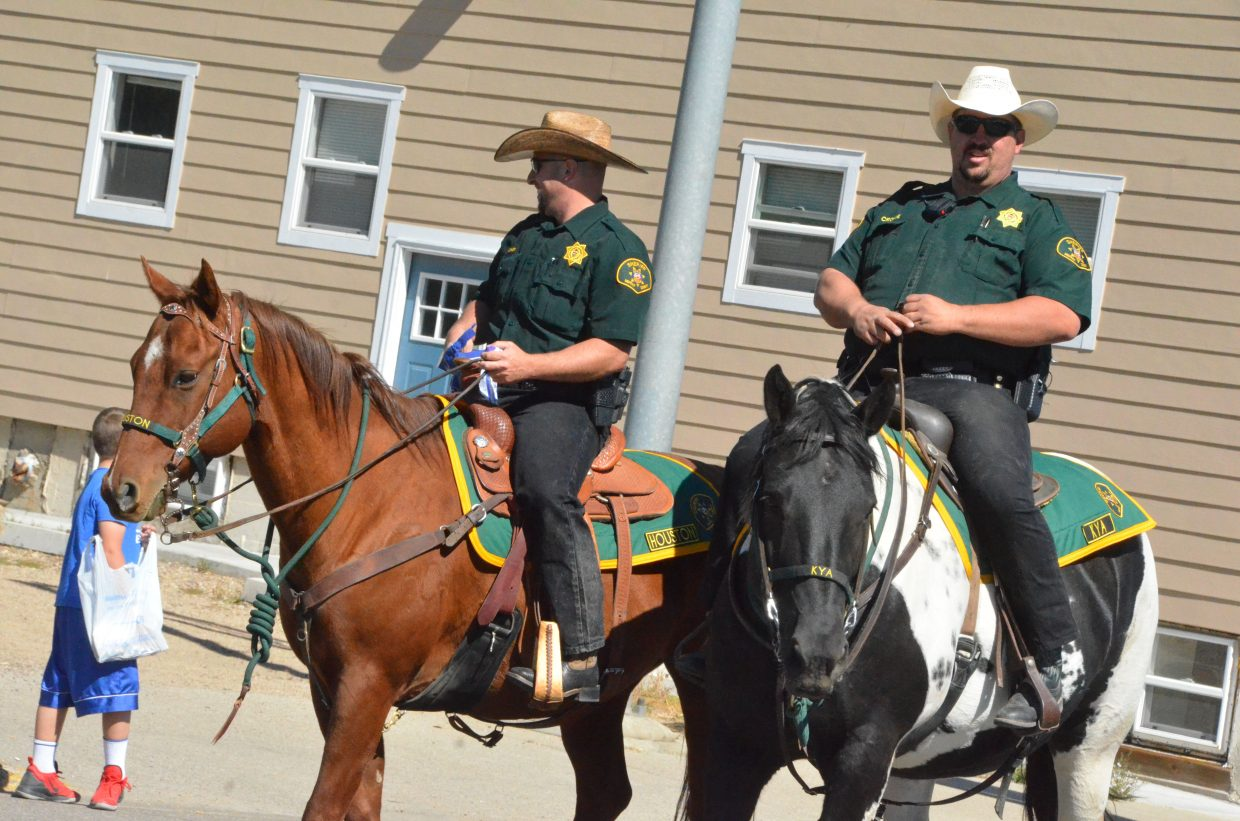 Mounted members of Moffat County Sheriff's Office bring up the rear to close Moffat County High School's Friday Homecoming parade.