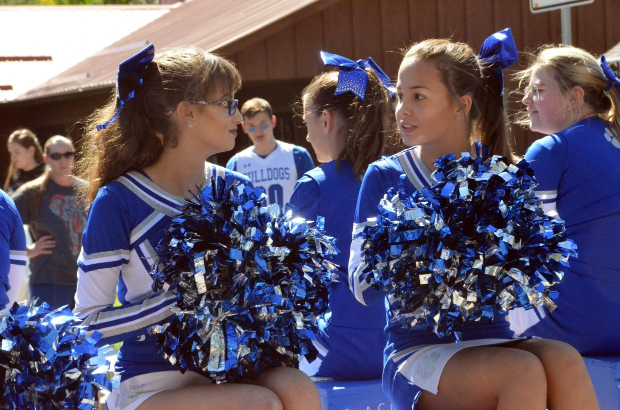 Moffat County High School cheerleaders chat during the Homecoming parade Friday.