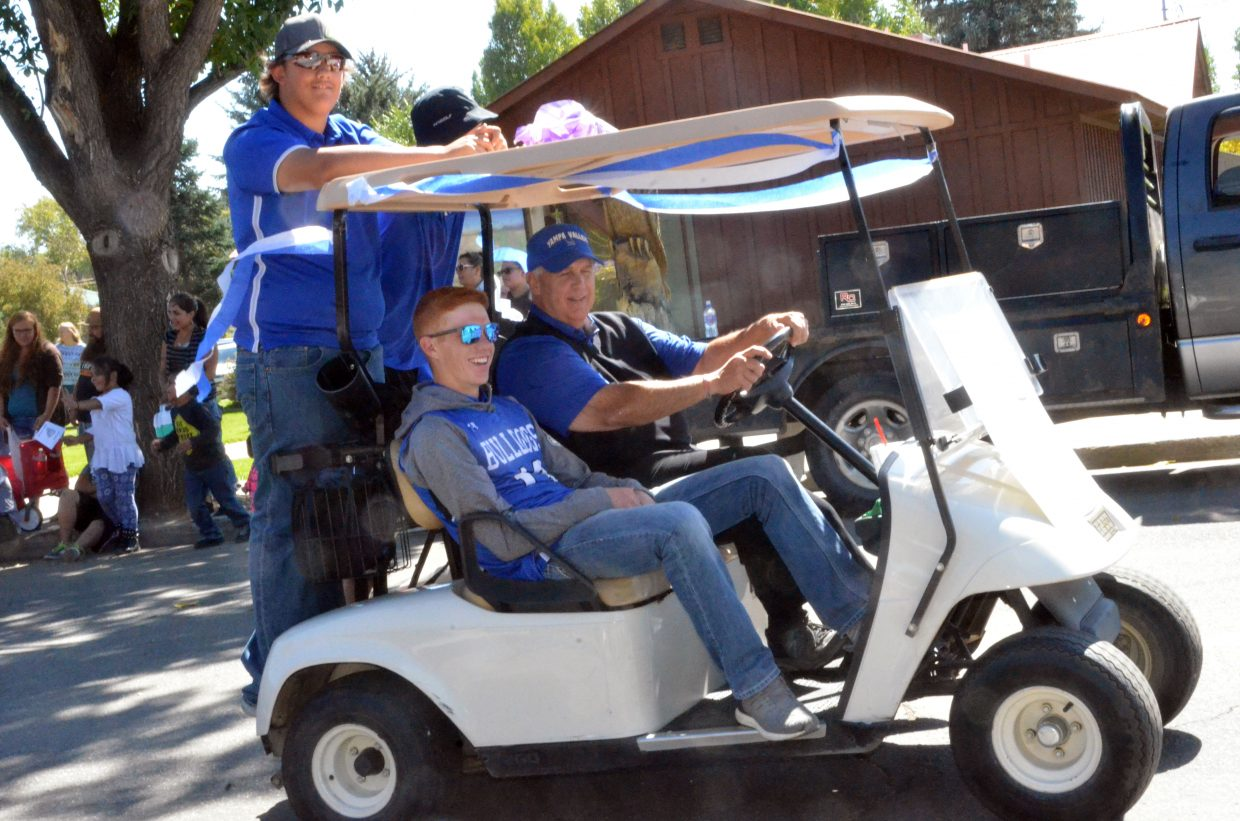 Moffat County High School golfer and state qualifier Torin Reed joins teammates during the Homecoming parade Friday.