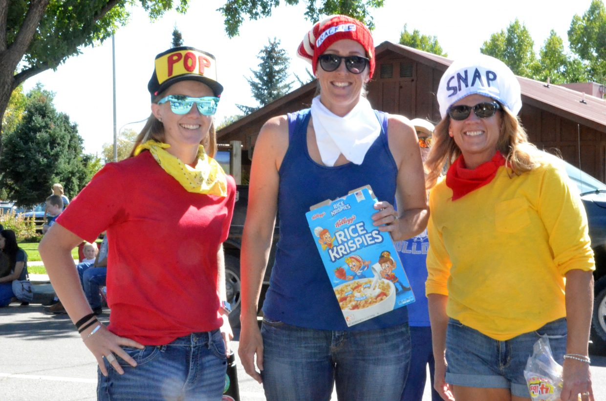 Moffat County High School volleyball coaches portray Rice Krispies' Snap, Crackle and Pop during the Homecoming parade Friday.